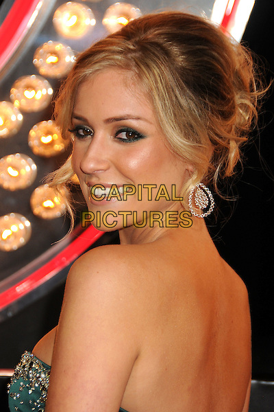 "KRISTIN CAVALLARI .""Burlesque"" Los Angeles Premiere held at Grauman's Chinese Theatre, Hollywood, California, USA, .15th November 2010..portrait headshot  hair up make-up green strapless gold beaded bustier silk satin jewel encrusted embellished earrings side back over shoulder rear behind .CAP/ADM/BP.©Byron Purvis/AdMedia/Capital Pictures."