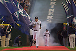 Seattle Mariners Matt Tuiasosopo, runs down the red carpet as he's introduced during opening ceremonies before the opening home game of the season with the Oakland Athletics at SAFECO Field in Seattle April 12, 2010.    Jim Bryant Photo. &copy;2010. ALL RIGHTS RESERVED.