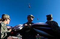 Helicopters fly over UVa ROTC cadets carrying an American flag before the start of the Virginia Cavalier vs. Duke Blue Devils football game Saturday Nov. 12, 2011. Photo/The daily Progress/Andrew Shurtleff