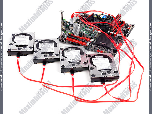 Hard drives connected to computer motherboard with a RAID controller isolated on white background