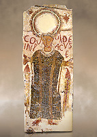 5th century Eastern Roman Byzantine  funerary mosaic from Tarbaka in the Roman province of Africa Proconsularis , present day Tunisia, with a crown at the top probably a Christogram  (Latin Monogramma Christi ) is a monogram used as an abbreviation for the name of Jesus Christ, with a figure below and a latin text for the deceased &quot; Covuldeus in peace&quot;. Either side of the figure are a lit candle which symbolises eternal faith. The Bardo National Museum, Tunis Tunisia.<br />