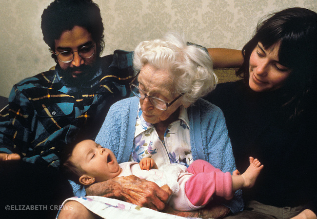 Berkeley CA young couple showing off baby, ten-weeks-old, to great grandmother, ninety-three  MR
