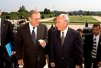 United States Secretary of Defense Donald H. Rumsfeld (left) escorts Minister of Foreign Affairs Shimon Peres of Israel into the Pentagon on August 1, 2002.  The two men will meet to discuss a range of issues of concern to both nations.  .Credit: R.D. Ward - DoD via CNP. /MediaPunch