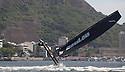 5th December, 2012. Rio de Janeiro, Brazil..Extreme Sailing Series 2012, Act 8..Images of ZouLou, skippered by Erik Maris (FRA), with tactician Philip Mourniac (FRA), mainsail trim Jean-Sébastien Ponce (FRA), headsail trim Patrick Aucour (FRA) and bowman Bruno Jeanjean (FRA)...Credit: Lloyd Images.