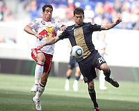 Cristian Arrieta #26 of the Philadelphia Union beats Juan Pablo Angel #9 of the New York RedBulls to the ball during a MLS  match on April 24 2010, at RedBull Arena, in Harrison, New Jersey.