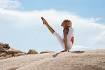 Beautiful yoga photography, earthing in the desert.