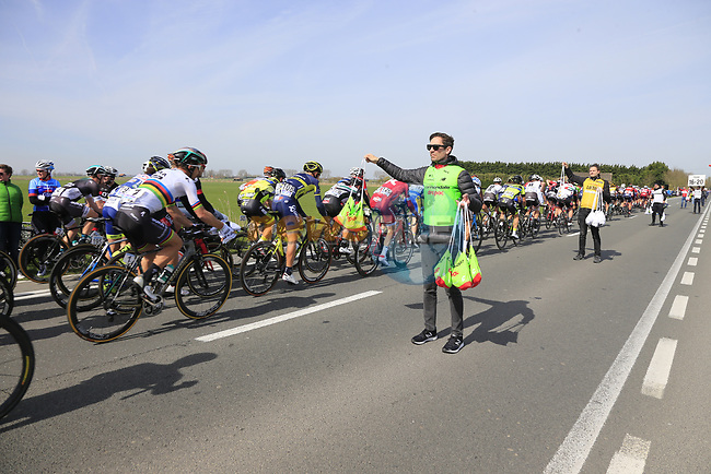 The peloton including World Champion Peter Sagan (SVK) Bora-Hansgrohe pass through the first feed zone at Steenkerke during Gent-Wevelgem in Flanders Fields 2017 running 249km from Denieze to Wevelgem, Flanders, Belgium. 26th March 2017.<br /> Picture: Eoin Clarke | Cyclefile<br /> <br /> <br /> All photos usage must carry mandatory copyright credit (&copy; Cyclefile | Eoin Clarke)