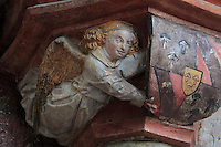Carved and painted angel from a pillar on the funerary monument of Ferry de Beauvoir, died 1473, Catholic prelate and 64th bishop of Amiens 1457-73, made 1490, in the South side of the choir, South ambulatory, in the Basilique Cathedrale Notre-Dame d'Amiens or Cathedral Basilica of Our Lady of Amiens, built 1220-70 in Gothic style, Amiens, Picardy, France. Amiens Cathedral was listed as a UNESCO World Heritage Site in 1981. Picture by Manuel Cohen