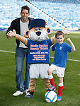 Neil Alexander promotes Family Section season tickets with young supporter Louis Smillie
