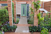 Front Yard Urban Vegetable Garden & House, townhouse garden with kale, climbing grape vines, flowers, tomatoes, front door, path walkway for edible landscaping