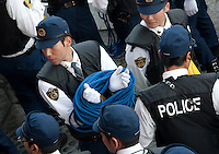 Tokyo police officer seems to be a bit tied up?