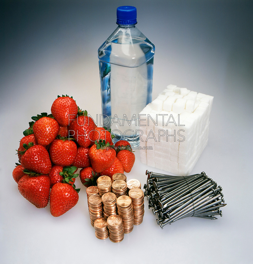 SAMPLES OF ONE KILOGRAM OF MASS.<br /> Water, Pennies, Nails, Sugar and Strawberries.