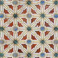 Alcazar, a natural stone waterjet and hand cut mosaic shown in Spring Green, Blue Macauba, Rojo Alicante and Renaissance Bronze polished, is part of the Miraflores Collection by Paul Schatz for New Ravenna Mosaics.<br />
