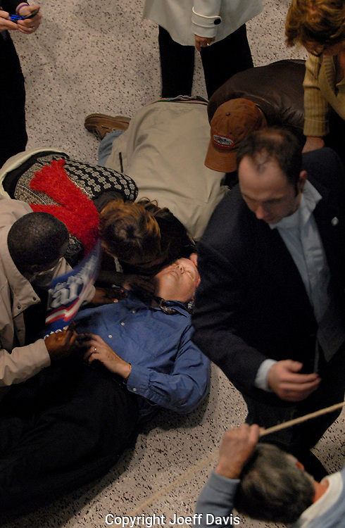ROCK HILL, South Carolina - January 25, 2008: A man passes out after Hillary Clinton's stump speech in Rock Hill, South Carolina. <br /> <br /> The next day Clinton lost the South Carolina Democratic Presidential primary by more than 28% to Barack Obama.<br /> <br /> More photos from the event here:<br /> http://tinyurl.com/6avx67f