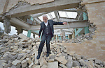 Father Emanuel Youkhana walks through the rubble of a church in Mosul, Iraq, on January 27, 2017. The church belonged to the Ancient Church of the East. According to neighbors, the Islamic State group--which took over the city in 2014--used the building as a warehouse until the final weeks of their occupation, when they awarded the building to a contractor who began to demolish it in order to salvage the steel rebar in the walls. Although this portion of the city was liberated in early 2017, Christians are unlikely to return soon due to concerns about their security in the Sunni community.<br /> <br /> Youkhana is a priest in Duhok of the Holy Apostolic Catholic Assyrian Church of the East.