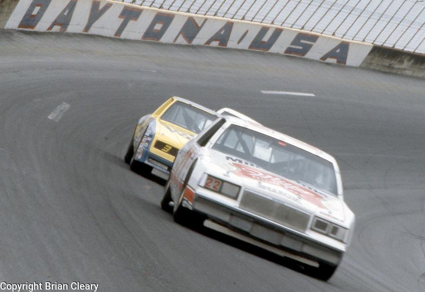Bobby Allison 22 Dale Earnhardt 3 turn 4 action Daytona 500 at Daytona International Speedway in Daytona Beach, FL on February 19, 1984. (Photo by Brian Cleary/www.bcpix.com)