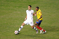 Clint Dempsey (8) of the United States (USA) is marked by Jhon Viafara (15) of Colombia (COL). The men's national teams of the United States (USA) and Colombia (COL) played to a 0-0 tie during an international friendly at PPL Park in Chester, PA, on October 12, 2010.