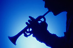 Silhouette of a man playing the trumpet with a blue background Lynnwood Washington State USA MR