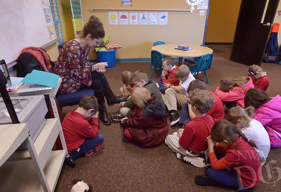 NWA Democrat-Gazette/BEN GOFF @NWABENGOFF<br /> Nikki Looney leads her 1st grade class in morning prayer on Monday Dec. 19, 2016 at Providence Academy's grammar school campus at Immanuel Baptist Church in Rogers.