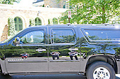 Photographers are reflected in the side of a Chevy Suburban, perhaps with former United States Secretary of State Hillary Clinton aboard, that returns to the Clinton residence in Washington, DC on Saturday, July 2, 2016.   It is believed the former Secretary was questioned by the FBI today in relation to her personal e-mail server that is the center of controversy.<br /> Credit: Ron Sachs / CNP<br /> (RESTRICTION: NO New York or New Jersey Newspapers or newspapers within a 75 mile radius of New York City)