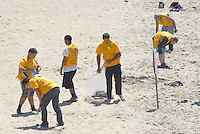 Members of World Mission Society Church of God clean the beach on Sunday, August 26, 2012..