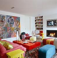 The colourful family room has a large plasma screen and is furnished with fun modular seating