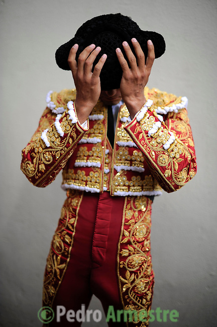 Spanish matador Matias Tejela gets ready before the fourth corrida of the San Fermin Festival, on July 10, 2012, in the Northern Spanish city of Pamplona. (c) Pedro ARMESTRE
