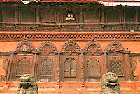 Architectural detail of the 18th century Shiva-Parvati temple in Durbar Square in Kathmandu. Images of Lord Shiva and his consort look out on the square from an upstairs window.