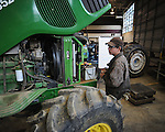 Lafayette High student Bram Billinsgly  troubleshoots tractor problems during the Northwest Federation FFA District Competitions at The Oxford-Lafayette School of Applied Technology on Friday, March 12, 2010..  OLSAT expected over 274 students, advisors, parents, and visitors on campus.