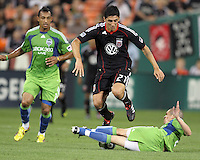 New signing Pablo Hernandez #21 of D.C. United leaps over Osvaldo Alonso #6 of Seattle Sounders FC during an MLS match at RFK Stadium on July 15 2010, in Washington DC.Seattle won 1-0.