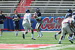 Ole Miss' Nathan Stanley (12) looks to pass during a scrimmage at Vaught-Hemingway Stadium in Oxford, Miss. on Saturday, April 2, 2011.