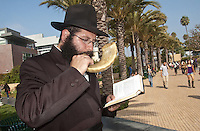 Rabbi Eli Levitansky blows the shofar during the Jewish  holiday of Rosh Hashana (literally &quot;head of the year&quot;) at Santa Monica College on Thursday, September 29, 2011. Rosh Hashanah marks the start of a new year in the Hebrew calendar. The shofar blast marks the beginning of the Ten Days of Repentance from Rosh Hashanah to Yom Kippur.