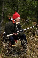 Beate Aase Heidenreich moose hunting with rifle.