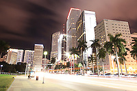 Condo, office and hotel buildings and traffic on Miami's Biscayne Boulevard at night (print version with logos).