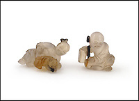 BNPS.co.uk (01202 558833)<br /> Pic: Woolley&amp;Wallis/BNPS<br /> <br /> Smalll but interesting...<br /> <br /> An astonished auction house has sold two tiny agate figures of Chinese boys for &pound;180,000 after an oriental bidding frenzy at its Salisbury sale.<br /> <br /> The tiny inch and a half long agate carvings were only expected to sell for a few hundred pounds but Woolley&amp;Wallis staff were amazed when the price shot through the roof before finally selling for 900 times the estimate.<br /> <br /> Auctioneer John Axford says 'I can only assume the figures are far older than we estimated, with such tiny items it's very difficult to assign an age'.