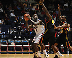 "Ole Miss' Demarco Cox (4) shoots as Grambling State's Steven Dandridge (42) and Demetri Wheeler (23) defend during the first half at the C.M. ""Tad"" Smith Coliseum in Oxford, Miss. on Monday, November 14, 2011.."