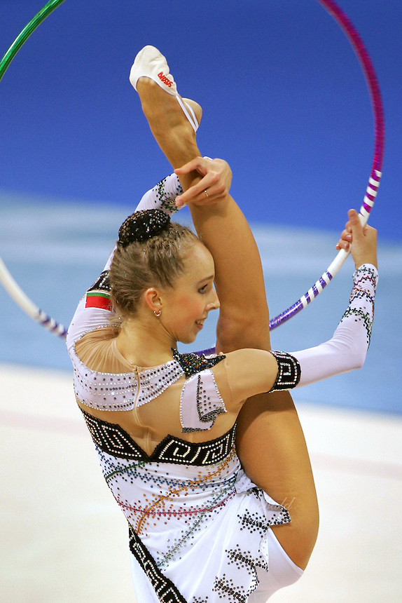 August 29, 2004; Athens, Greece; Rhythmic gymnastics star INNA ZHUKOVA of Belarus performs with hoop in All-Around competition at 2004 Athens Olympics.<br /> Copyright 2004 Tom Theobald