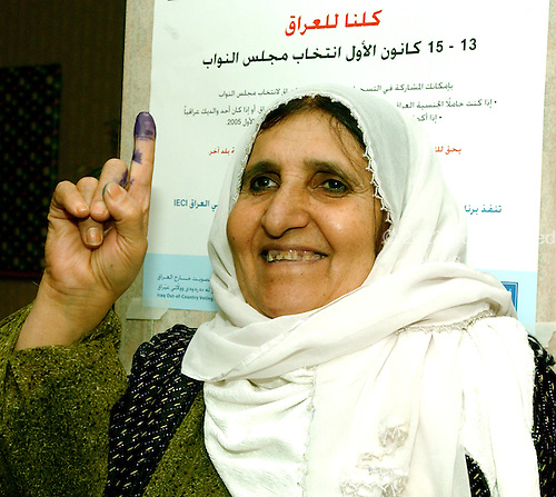 McLean, VA - December 13, 2005 -- Fatima Pishdar, a Kurd from Northern Iraq, who emigrated to Manchester, New Hampshire, proudly hold up her index finger staines with purple ink to indicate she voted in the Iraqi election in McLean, Virginia on December 13, 2005..Credit: Ron Sachs / CNP.(RESTRICTION: NO New York or New Jersey Newspapers or newspapers within a 75 mile radius of New York City)