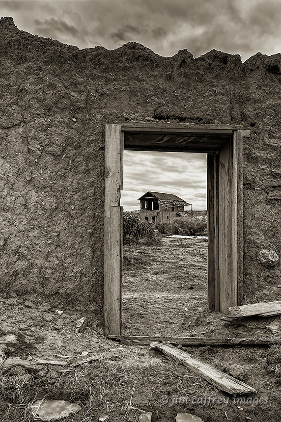 Sepia toned image of adobe ruins in the ghost town of Guadalupe, New Mexico in the Rio Puerco Valley, San Juan Basin of northwestern New Mexico.