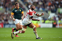 Michael Leitch of Japan passes the ball. Rugby World Cup Pool B match between South Africa and Japan on September 19, 2015 at the Brighton Community Stadium in Brighton, England. Photo by: Patrick Khachfe / Onside Images