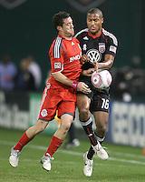 Jordan Graye #16 of D.C. United clashes with Dan Gargan #8 of Toronto FC during an MLS match that was the final appearance of D.C. United's Jaime Moreno at RFK Stadium, in Washington D.C. on October 23, 2010. Toronto won 3-2.