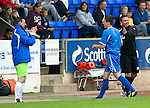 St Johnstone v Man Utd XI....31.07.10  Alan Main Testimonial.Nicholas Main gets a pat on the back from Derek McInnes and applause from his Dad after scoring a penalty.Picture by Graeme Hart..Copyright Perthshire Picture Agency.Tel: 01738 623350  Mobile: 07990 594431