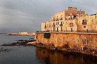 General view of Lungomare d'Ortigia, Syracuse, Sicily,  with Castello Maniace in the distance, pictured on September 14, 2009, at dawn. The island Ortigia is the historic centre of Syracuse. Today the city is a UNESCO World Heritage Site. Picture by Manuel Cohen.
