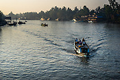 Ferry boats on Bogale river in Pyapon district of Myanmar.