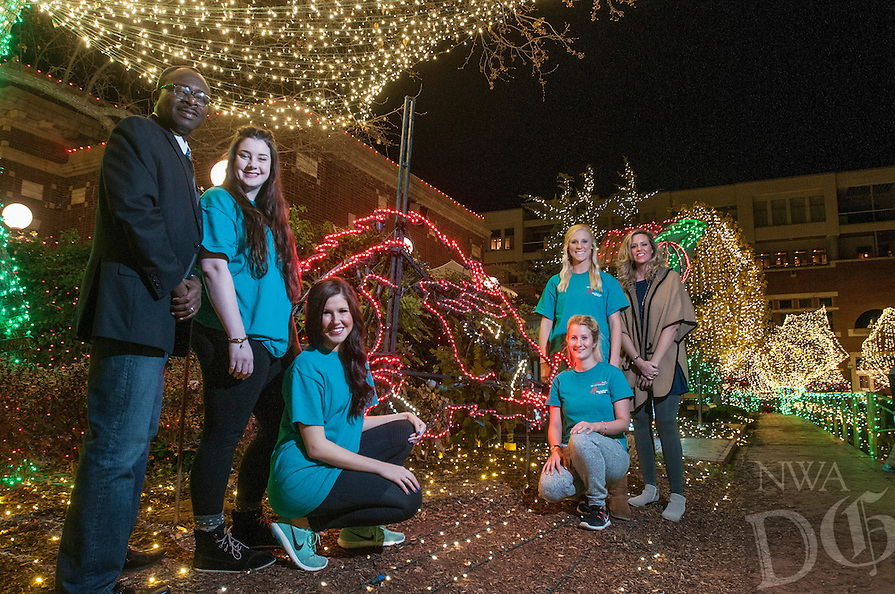 NWA Democrat-Gazette/ANTHONY REYES &bull; @NWATONYR<br /> Godwin-Charles Ogbeide (from left) hospitality professor for the University of Arkansas, hospitality students Lauren Simpson, Melanie Grubb, Allie Coss, Rosa Weinhold and Ashley Byrd, graduate assistant, Wednesday, Dec. 9, 2015 on the Fayetteville square. Hospitality students organized the opening ceremony for the Lights of the Ozarks.
