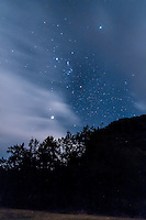 Orion upside down and in moonlight over Timor Rock, Coonabarabran, NSW, Australia. Jupiter is bright object below, Sirius is bright star above. Taken Dec 6, 2012 with Canon 60Da and 10-22mm lens for 60 seconds at f/3,5 and ISO 3200.