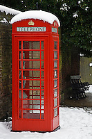 Snow covered red telephone box in Hampstead, North London, United Kingdom