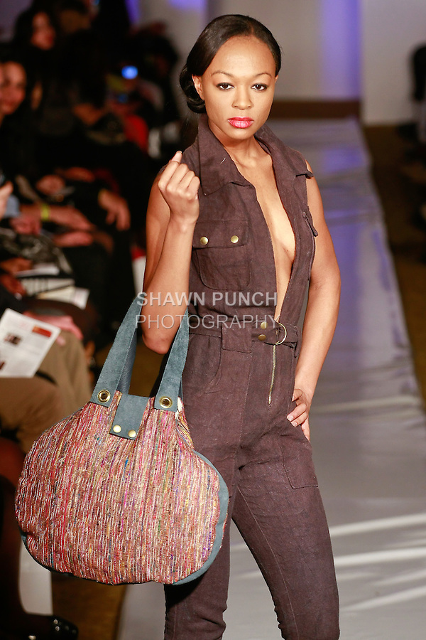 Model walks runway in an outfit from the Pretty Birdie Fall 2012 Birds in Balance collection, by Stephanie Teague, during Plitzs Fashion Week New York Fall 2012.
