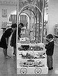 Pittsburgh PA: View of Christmas in store display at Horne's department store in downtown Pittsburgh. Child playing with steel toys on display during the Rhapsody of Steel campaign.  US Steel launched an awareness campaign of all the current uses of steel in everyday products.  During this time, ALCOA Aluminum Company of America also headquartered in Pittsburgh, was aggressively competing to enter markets where US  steel companies traditional dominated market share. Examples included beer and food Cans, appliances, automobile parts, children toys / bicycles, and more.
