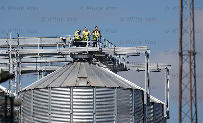 A couple of guys getting a free view of the match from the industrial estate